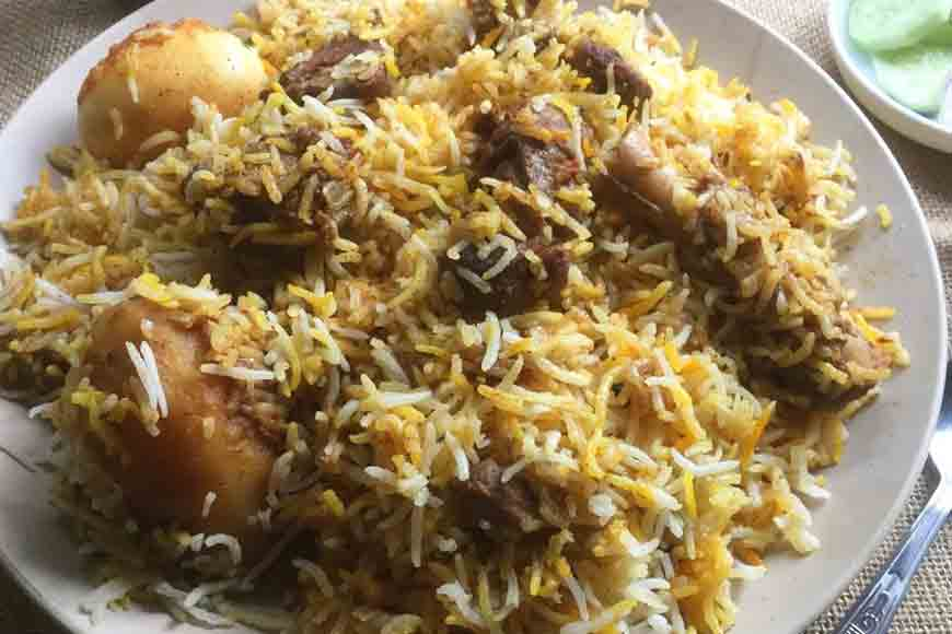 Why potato was added to Calcutta Biriyani by Wajid Ali Shah's cooks?