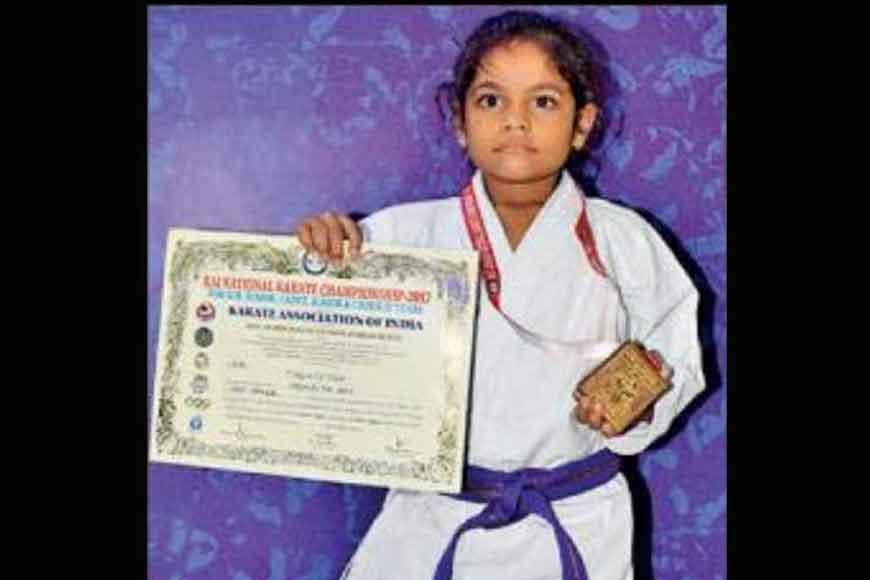 Eight-year-old karate champ fetches gold for country